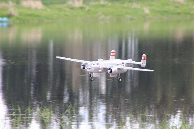 b-25 flying over pond